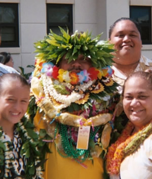 Young Graduate Receives an Abundance of Leis