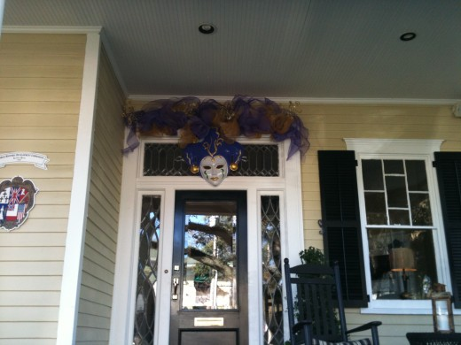 In this case, the door butts up against a wall so the best look is this above the transom decoration.