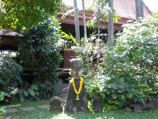 Flower necklaces are part of Buddhism everywhere in Thailand, including Jim Thompson's House & Museum in Bangkok.