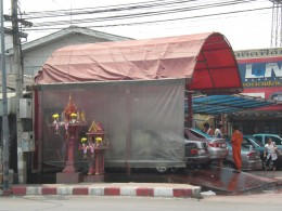 Thai Spirit Houses protecting car wash business.