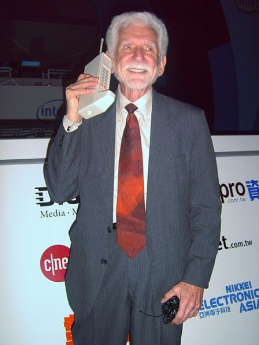 Dr. Martin Cooper of Motorola making a call on his Smartphone in 2007.  This advanced unit won't be out until next year.
