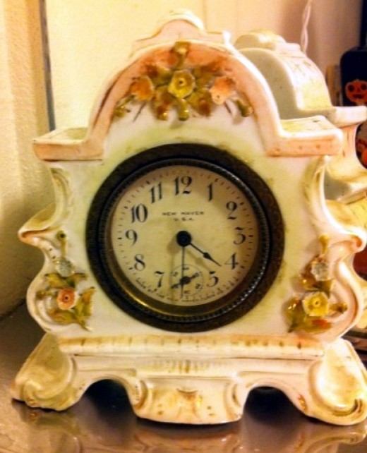 Antiques can be thrifty editions, adding elegance, flair, funk, or sheer uniqueness.  For my shabby chic style I found this porcelain, wind-up clock from the early 1900's at Goodwill.  Price: $4.00!