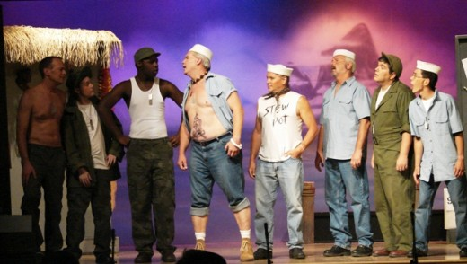 "South Pacific's ""Nothin Like A Dame"" ""Billis"" (Steve) yells at ""Sailor"" (Demar) while ""Stew Pot"" (Ken) looks on."