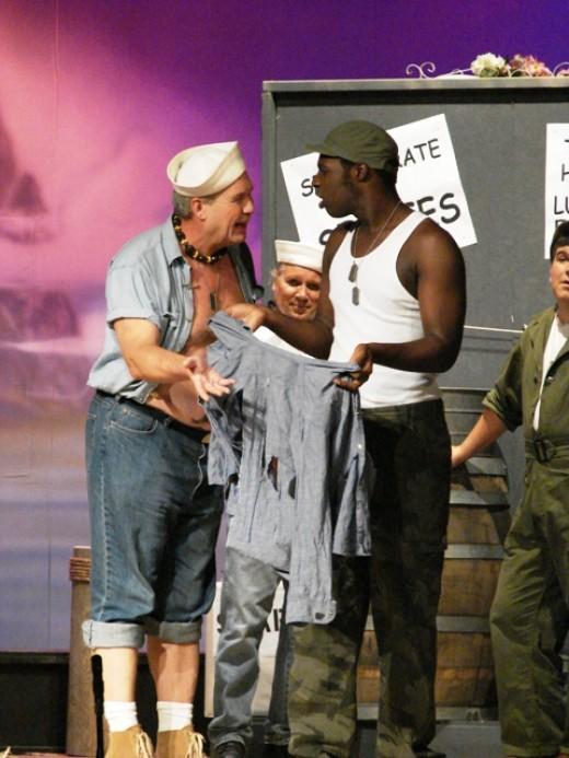 """""""Billis"""" (Steve) explains to """"Sailor"""" (Demar) how he wants his laundry done."""