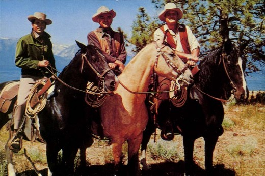 "(FROM LEFT) MICHAEL LANDON, ""LITTLE JOE,"" LORNE GREEN ""BEN"" AND DAN BLOCKER, ""HOSS"" TAKE A BREAK FROM RIDING OVER THEIR MASSIVE ACREAGE NEAR CARSON CITY, NEVADA CALLED THE PONDEROSA."