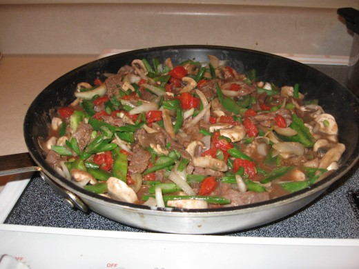 Smothered steak makes a delicious choice over rice or noodles.