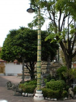 Lamp posts were also included in the artistic design of elements within the Buddhist Complex of Wat Pho. Bangkok, Thailand.