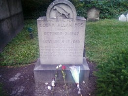 The site of the Poe Toaster's annual visit.  The roses and cognac were probably left by an admirer of Poe and the Toaster.