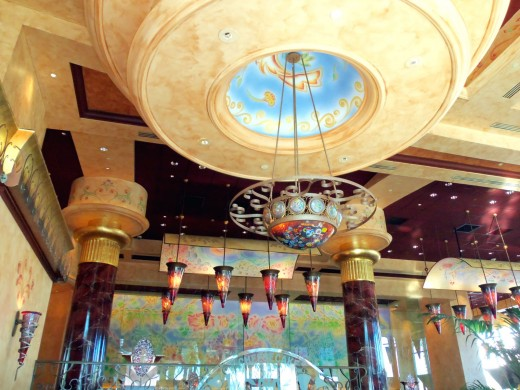 "- An example of the magnificent, skillfully crafted ceiling edifices & wrought iron  fixtures supporting ""Spearhead Lamps"" which adorn the entire restaurant - Backdropped by a wall sized stain glass mirror - Very reminiscent of a ""Cathedral"" -"