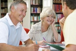 Three writers in the library, a stock photo