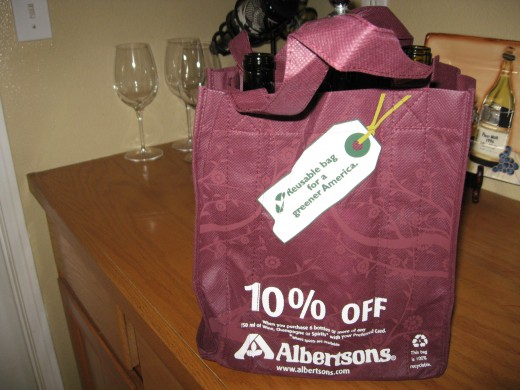 This is a handy 6 pack of wine carrier bag. And, the beauty of this one is it is a coupon and a handy carrying case for your wine! Return it and fill it up with 6 bottles of wine for 10% off EVERY time!