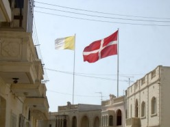 Vatican flag and the flag of the Knights of Malta