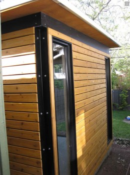 The base Functional Cabana, with two of its four full-height windows and horizontally-oriented cedar siding.