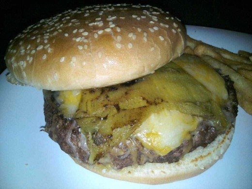 A hamburger topped with Angel Fire Chili which has been roasted and topped with melted Cheddar Jack cheese makes your mouth melt!  It will bring you back again and again!  I have!
