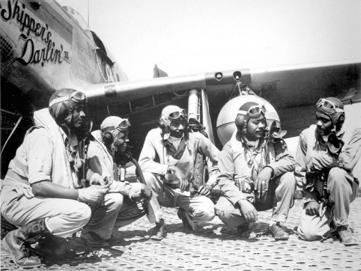 At the Air Field in Italy: Pilots Lt. Dempsey W. Morgran, Lt. Carroll S. Woods, Lt. Robert H. Nelron, Jr., Capt. Andrew D. Turner, and Lt. Clarence P. Lester. (U.S. Air Force photo)