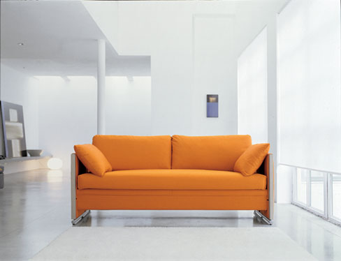 Pulling a couch off of the wall can provide a divider of different spaces in a room