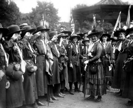 """""""Lady Baden Powell inspecting the guard of honour of Girl Guides at Battersea Park in 1916""""."""
