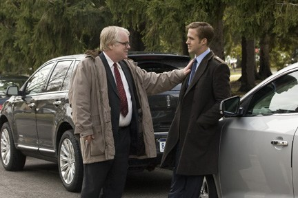 "Hoffman gives Gosling some words of advice in ""The Ides of March."""
