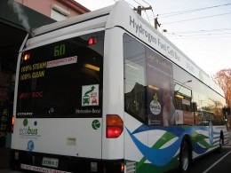 A hydrogen fuel cell public bus accelerating at traffic lights in Perth, Western Australia.