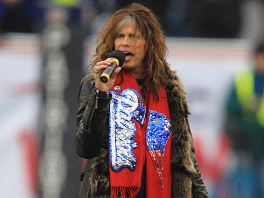 Steven Tyler sports a Patriots scarf as he sings the National Anthem in front of a packed house at Gillette Stadium before Sunday's kick off.