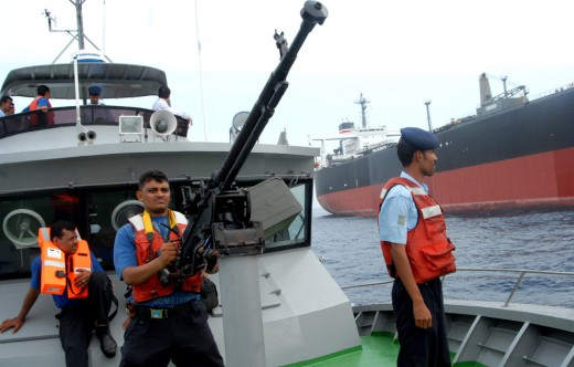 Yemeni coast guard escort the damaged Japanese tanker Takayama into the port of Aden. Many of the Yemeni coast guard do not know how to swim and lack the resources necessary to cover the areas of open water where pirates are active.
