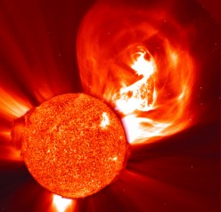 Photo of a solar storm shooting into space.