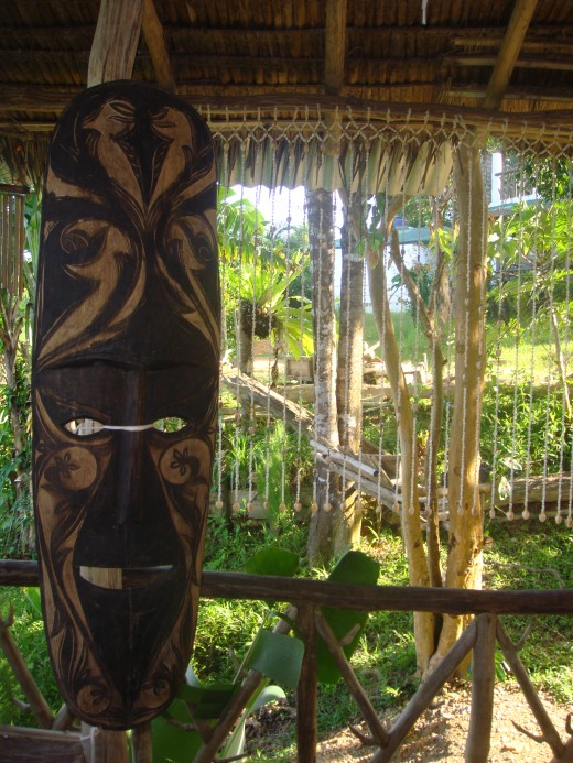 Tribal art and interesting souvenirs lined a small wooded bamboo structure overlooking the natural beauty.