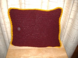 Another pillow using this pattern. I did not have enough burgundy yarn, so I had to make this one rectangular, instead of square. You can experiment with the size and shape of the pillows you make.