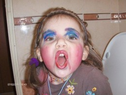 This is just a tad bit young for this! Playing dress up is fine... but it looks like someone got into Mom's makeup! ;)