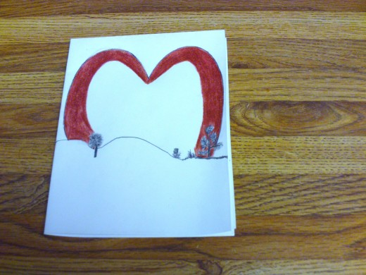 Here I continued coloring in the heart with the red colored pencil