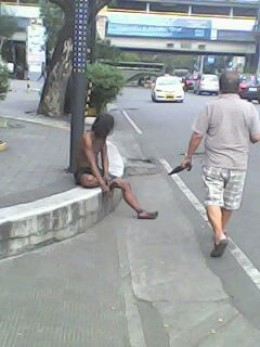 The legendary TAONG GRASA (Greasy Man) in the Philippines - let's help him!!! (Photo from Cellular phone by Travel Man)
