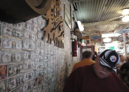 Dollar bills decorate every inch of the restaurant walls! People from all over the world have left them since the fire of 1987!