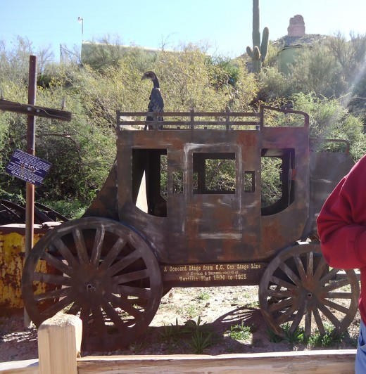 Replica of a stage coach on display.