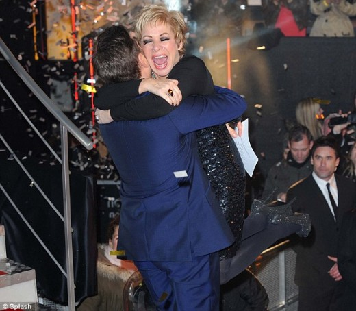 An overjoyed Denise Welch hugs Big Brother host Brian Dowling after winning the 2012 series
