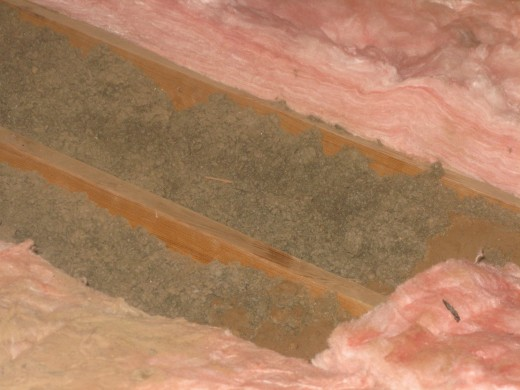 The brown is the old insulation, the pink the new.  While blown-in insulation is what was already there and that's what is recommended that you add, roll-in is way easier to handle.