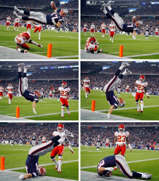 Rob Gronkowski bounces head first off of the field while scoring a touchdown against Kansas City.