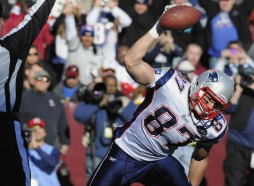 Record breaking tight end, Rob Gronkowksi, celebrates with his famed Ground Pound during his historic run.