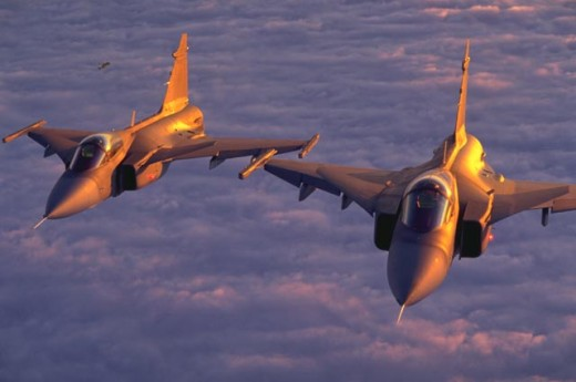 Two JAS-39 Gripens flying above the clouds