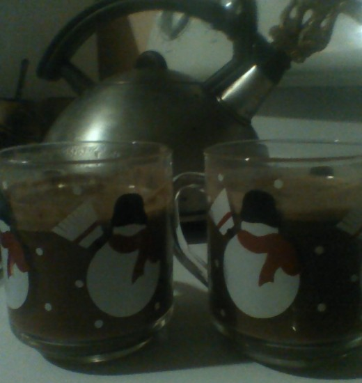 Dragon kettle and 2 cups of warm cocoa to sip after frosty frolicking