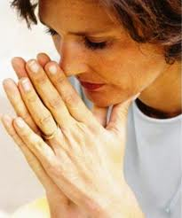 No matter what some people believe, the majority of us still need to believe in God and pray to God. So this praying woman may be praying for whatever she needs to pray. In our case here we are praying God to guide and help us.