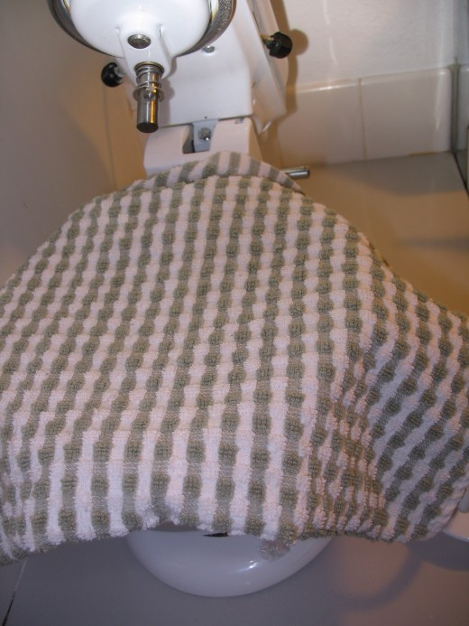 Cover with a kitchen towel