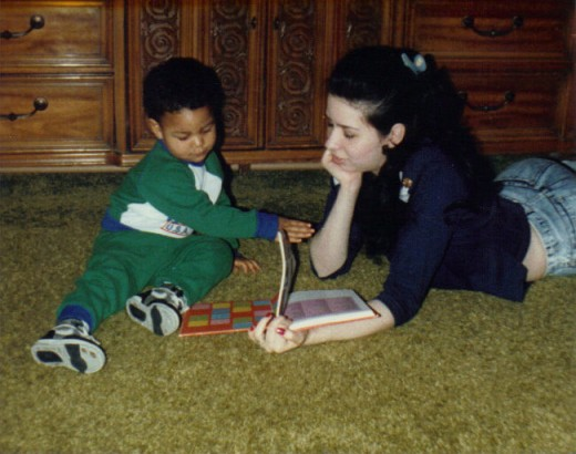 Me and my son Michael (2 yrs old) reading an encyclopedia.