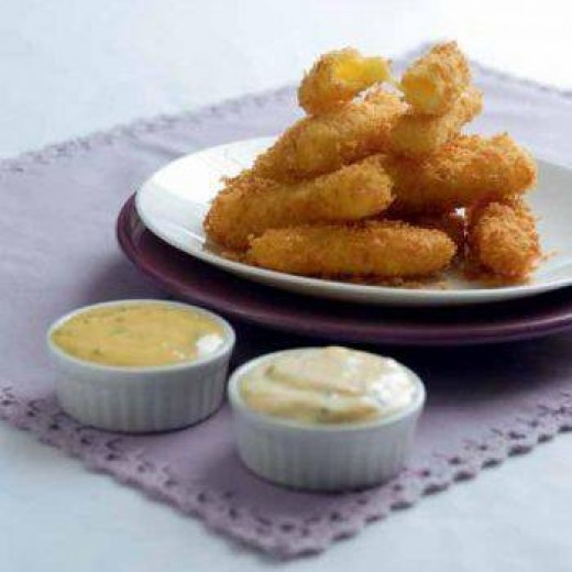 Fried cheese sticks are super easy to make and can make your Super Bowl party a hit!