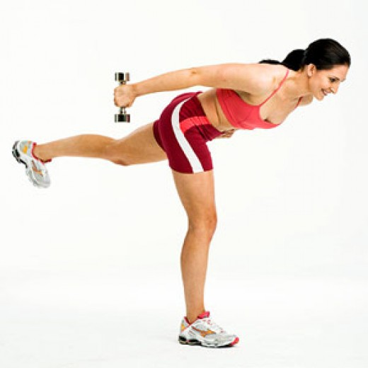 An example pose of a woman from Fitness Magazine doing Tricep Kickbacks