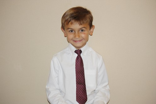 My son sporting his tie at a friend's wedding!