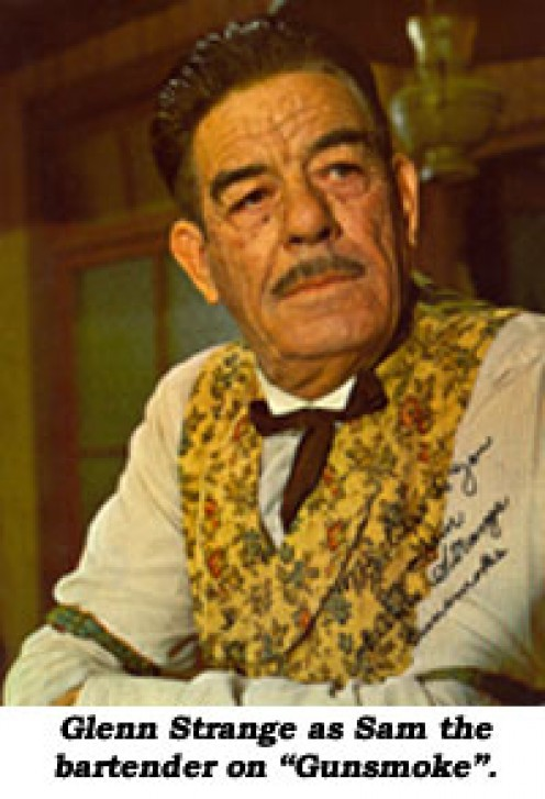 "GLENN STRANGE AS ""SAM,"" KITTY RUSSELL'S (AMANDA BLAKE) BARKEEPER IN THE LONG BRANCH SALOON."