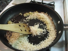 Brown rice (about 1 cup) in olive oil. Add more olive oil if necessary to insure each kernel of rice is coated and lightly browned.