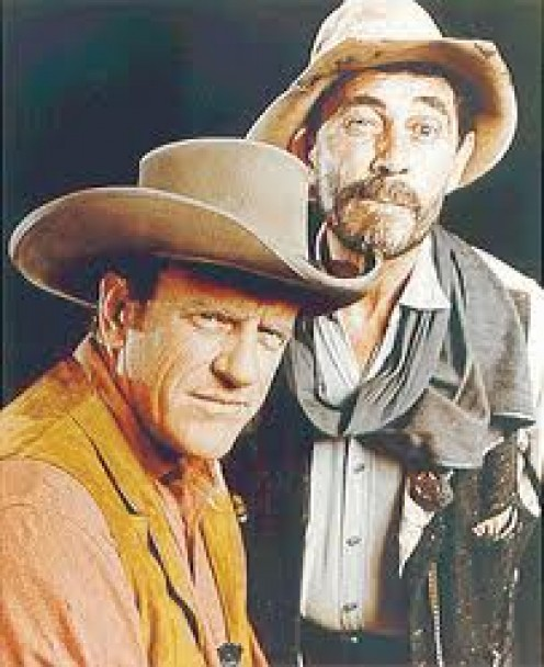 "JAMES ARNESS, ""MATT,"" AND KEN CURTIS, ""FESTUS."""
