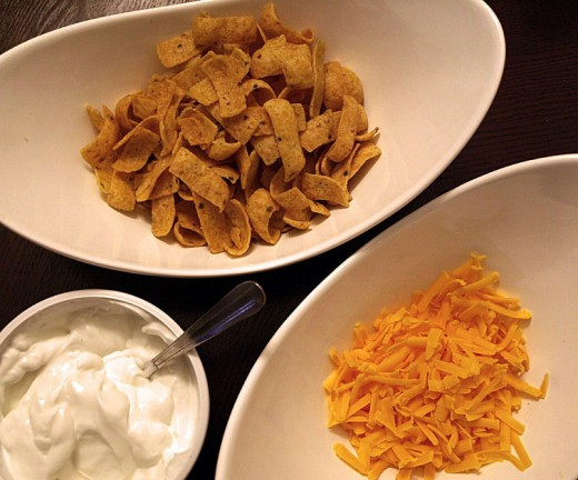 14.  When you ready to serve your chili, you can add Fritos, cheddar cheese and sour cream.