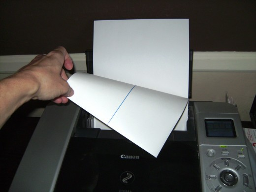 Make sure to load the paper correctly.  Print on the side without the line.